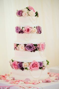 Pretty purple and pink #wedding cake captured by Larry Mc Mahon Photography |  flowers by floralearth | onefabday.com