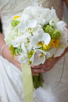 BRIDE:  soft,country,but modern....white ranunculus,white peony,white hydrangea,green vibirnum,canary yellow ranunculus,phalaenopsis white orchids,solidago as a filler,soft pale yellow steamer completed the look