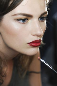 thick brows, full red lips