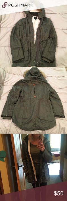 Forever 21 green trench coat Great for fall and winter and even rain. Warm inside. Fur on hood/hood all together is detachable. Small tear in one of the pockets but it doesn't go all the way through. Size L but I wear a small and like the oversized fit Forever 21 Jackets & Coats Trench Coats
