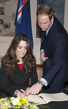 Kate arrives in London to sign the book of condolences, she puts pen to paper as William watcheS