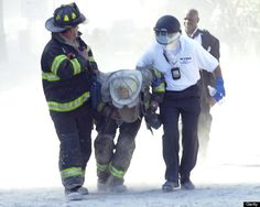 Firefighter Louis Cacchioli (left) from Engine 47 in Harlem helps carry Battalion Chief Michael Telesca of Battalion 19, Bronx (center) who was inside the basement of the south World Trade Tower (#2) when it collapsed, with the assistance of an unidentified Police Officer. (Photo by Thomas Monaster/NY Daily News Archive via Getty Images) #NeverForget