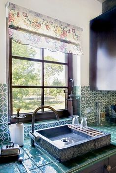 Looks like a slab built sink, surrounded by some nice tile-work, artist unknown.