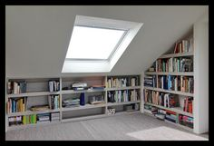 We love how this loft conversion creates a reading nook with loads of storage --- werkkamer-zolder-opbergruimte-boekenkast-slim-veluxraam-velux-licht Attic Bedroom Small, Attic Bedroom Designs, Attic Bedrooms, Attic Design, Attic Bathroom, Attic Spaces, Bathroom Small, Attic Renovation, Attic Remodel