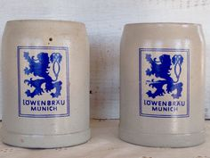 Vintage pair of Lowenbrau stoneware beer mugs. These will surely keep your beer cold!from my Etsy shop https://www.etsy.com/listing/592169403/vintage-pair-of-handmade-salt-glazed