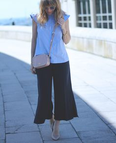 LADY IN CULOTTES Street style wearing blue blouse and camel bag