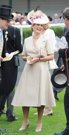 Sophie, Countess of Wessex, arrived at Ascot in a beige wrap dress, nude courts and matching hat with purple tuile