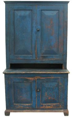 """Early 19th century New York State, Stepback Cupboard, with wonderful original blue paint, The doors are very unusual wide chamfered panels,and mortised and pegged, applied base molding, with a small crown molding at the top, original red painted interior, with a five 5' pie shelf.21 3/4"""" deep x 46"""" wide x 80 3/4"""" tall"""