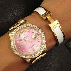 Love the rose color face with gold.