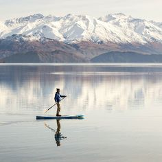 Early bird catches the worm. Or in our case still reflections as I'm gliding with happiness Allan Dixon @daxon in Wanaka New Zealand . . . #sup #standuppaddle #standuppaddleboard #suplife #paddleboard #standupsurf #standupboards #paddleboarding #standuppaddlesurfing #travel #destinations #happy #paddleboarding #neverstopexploring #adventure #smile #happy #supsurf