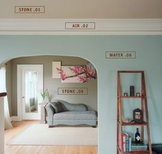 Yolo Colorhouse- eco-friendly paint. I like this arched entry from dining to living room also.