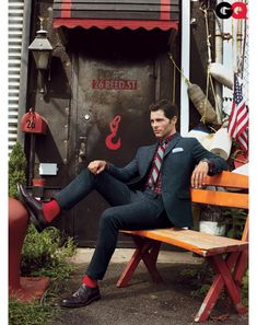 James Marsden—black accented by reds. Suit by Club Monaco; shirt by Saturdays NYC; tie by Brooks Brothers; socks by Pantherella; shoes by Alden.