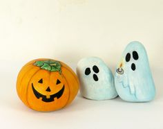 Painted Halloween rocks - pumpkin and ghosts - love the little candle