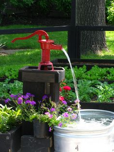 Antique Water Pump Fountain by E. Carson Meeder Fine Landscaping