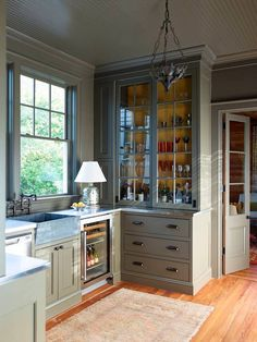 Small Kitchen Remodeling Photo Credit: Eric Piasecki - gorgeous sage kitchen with glass fronted tall floor to ceiling cabinetry Sage Kitchen, Grey Kitchen Cabinets, Kitchen Redo, Kitchen Flooring, New Kitchen, Kitchen Storage, Kitchen Counters, Stylish Kitchen, Kitchen Lamps