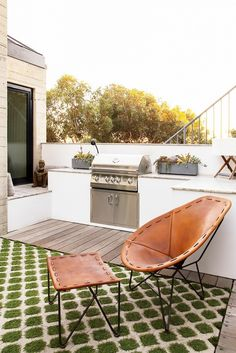 Outdoor patio space with a leather armchair