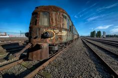 Rotterdam-based urban photographer Brian has captured a piece of history that's slowly fading into oblivion: the Grand Orient Express. The train defined luxury back in 1883 when it was launched by the Compagnie Internationale des Wagons-Lits (CIWL). Abandoned Train, Abandoned Cars, Abandoned Mansions, Abandoned Buildings, Abandoned Places, Orient Express Train, Simplon Orient Express, Grand Orient, Haunting Photos