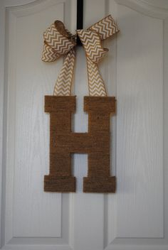Front Door Letter. I like that this looks like it's held by a door hanger! That's so smart because I was wondering how to hang the letter or wreath!!