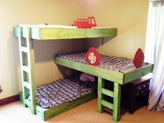 Triple bunk beds. The finish on this is horrible. It would look so nice with a super modern look. Love the triple kid beds and storage underneath