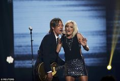 Joining forces: American Idol winner Carrie Underwood will serve as Keith's support act on tour