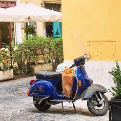 Shopping does look better on this night blue Vespa! Roma! Photo by Lisa van de Pol ❤️  #rome #roma #vespa #scooter #italianstreets #whatitalyis #summerinitaly #browsingitaly #browsingrome #igersroma #roman #romanlife #romeandme...
