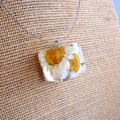 Handmade resin necklace with pressed daisies $32 Etsy