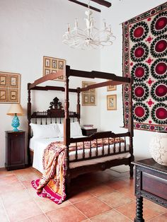 Spanish colonial furniture and suzanis mix well in this bedroom