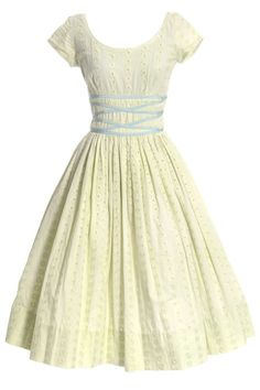 Yellow 50's Sundress This Jerry Gilden late 1950's vintage dress would be a perfect addition to your summer wardrobe! This pretty vintage dress is in a sunny yellow daisy flower eyelet and has blue ri