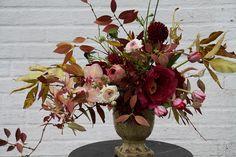 Wish it were my creation!  Autumn leaves, burgundy flowers, by Sarah Ryhanen