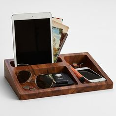 A place for everything and everything in its place. Add this mid-century inspired catchall to a nightstand or dresser and they may find their eyeglasses, watches and loose change are suddenly a lot easier to find. As decorative as it is useful, this acacia wood tray is divvied up into three recessed areas that help keep things organized in impeccable style.