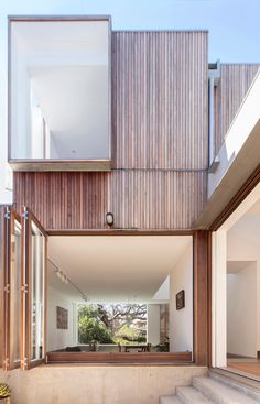 Stacked windows face a 116-year-old tree in Panovscott's Sydney cottage extension