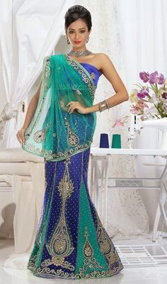 This designer blue and cyan blue lehenga saree is designed in two tone panels which gives you a lehenga effect from the hem. It is designed in zardosi embroidery pattern with beads cutdana, moti, patch, resham or stone work all around in border or butta with scattered butties and sequence. The palav is of single tone. Saree comes with matching stitched blouse as shown in the picture. #BuyLehengaSarees #BridalLehengaStyleSarees