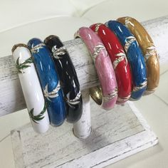 """OCEAN JEWELERS HWN Bangles Beautifully crafted, Hawaiian bangles.  Gold tone with hand painted enamel designs. this bracelet features a palm tree. Fits wrist sizes 6.5"""" - 8.5"""" because of the wide hinge opening for easy on and off. Ocean Jewelers Jewelry Bracelets"""