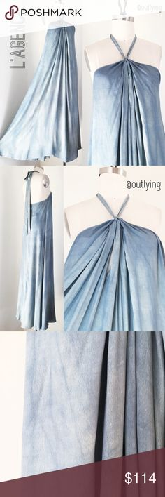 L'AGENCE Acid Wash Halter Maxi Dress L'AGENCE Acid Wash Ocean Maxi Dress Retail Price: $395 NWOT Sample Size: XS Color: Light blues Length 60, Bust 30 (please measure around the chest, above your chest at your sternum bone for the best fit) Waist (free) Hip (free) Full volume in a luxurious tie dye/acid wash viscose fabric with a light crepe feel, halter tie neck, side zipper, inner keyhole front with gathered pleats at the front neck. Stunning and a one of a kind piece. I would keep this…