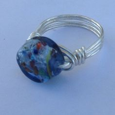 30% Off Bundles Handmade Wire Wrap Ring Milifori glass wrapped in sterling silver plated tarnish resistant meaning it holds up to everyday wear. One-of-a-kind every wrap comes out different making it unique to it's owner. Cindylou's Design Jewelry Rings