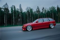 Russian Hellrot BMW e36 touring on BBS RS wheels