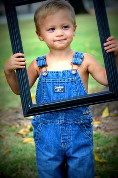 My beautiful 2 year old nephew ! He has a identical twin,that wanted no part of the picture frame ! Great idea for a framed face picture .