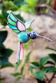 Handmade marbles and stained glass hummingbird