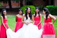 A red bridal party at Hendon Hall Hotel, North West London  #weddings #weddingphotography #londonweddingphotographer
