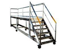 Custom designed rolling ladders Our Access Platforms are idea for manufacturing factories  & others.