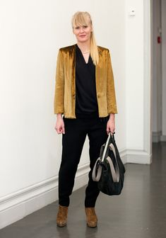 "Jenny, 33  ""I like to wear black and Filippa K. The fringe is my trademark.  Now I'm wearing a Filippa K jacket, a wrap shirt and trousers from Lindex Affordable Luxury collection and a Beatriz Furest bag from Barcelona."""