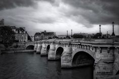 Pont Neuf Paris. This is one of my favorite bridge in Paris I had a rainy weather so I made it black and white to add some drama to the photo!  Do you guys go for a black and white look when you have a bad weather? #photoserge #blackandwhite #bridge #view #paris #sky #cloud #drama #view