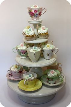I have to get more fancy tea cups now!! Perfect way to display cupcakes.