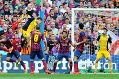 Diego Godin of Atletico de Madrid scores his team's first goal during the La Liga match between FC Barcelona and Club Atletico de Madrid at Camp Nou on May 17, 2014 in Barcelona, Catalonia.
