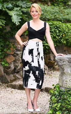 Elizabeth Banks from The Best of the Red Carpet  Always picture perfect, the actress dons a slick Donna Karan crop top set with Sophia Webster heels at the Pitch Perfect 2 photo call in Rome.