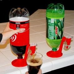 Details Keep your soda fizzy and turns the bottle into a beer key-like pourer. The soda will stay carbonated and you can pour it right from your fridge. Material: ABS Plastic Color: Red,show as picture Size: Base diameter:10.2cm Type: Bar Tools Certification: CIQ Diameter: <5cm Bar Tools Type: Cocktail Whisks Feature: Eco-Friendly Material: Plastic Plastic Type: PE