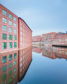 In #Tampere , calm waters of the #Tammerkokski can reflect #Finlayson and #Tampella buildings just like in a giant mirror! Laura Vanzo - Visit Tampere - @VisitTampere