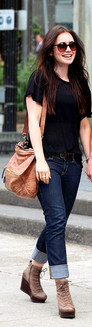 Lily Collins, in a black tee, wedge combat style shoes, & rolled up jeans