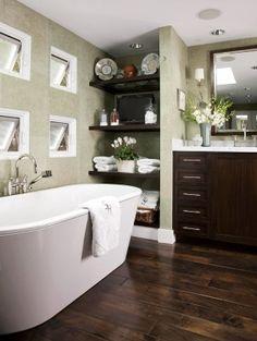 Love the dark wood floor, green, and dark vanity -- Perfect inspiration for spa bathroom