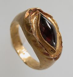 Finger Ring with Oval Bezel Date: 7th century Geography: Made in Northern France Culture: Frankish Medium: Gold, garnet cabochon